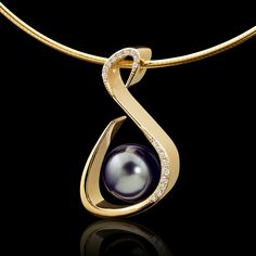 A modern pendant design by Adam Neeley. Serenity Pearl Pendant is energetic and pure. In this unique pendant design, a stunning Tahitian pearl is accented by diamonds, set in 14 karat yellow gold.