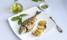 Grilled dorada fish with lemon and spinach photo by on Envato Elements Fish Recipes, Lunch Recipes, Olive One, How To Cook Asparagus, Healthy Herbs, Healthy Grilling, Barbecue, Entrees, Spinach