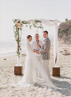beach wedding with simple arch with draped fabric florals and greenery #beachwedding #weddingceremony #weddingchicks http://www.weddingchicks.com/2014/02/05/dos-pueblos-ranch-wedding-2/