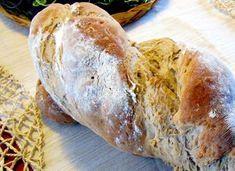 Domácí kynutý chleba připravený ze dvou druhů mouky, olivového oleje a bílého jogurtu. Pak stočený a pečený v klasické troubě.