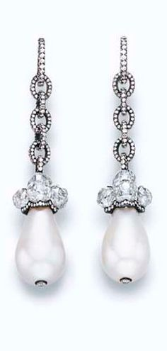 A PAIR OF PEARL AND DIAMOND EAR PENDANTS, BY JAR  Each set with a drop-shaped natural pearl, measuring approximately 14.28 x 19.15 and 13.80 x 20.30 mm, with a diamond collet terminal, topped by an antique Indian diamond bead cluster in a pavé-set diamond cap, suspended from pavé-set diamond interlocking links, mounted in silver and 18k gold, in a JAR pink leather fitted case By JAR
