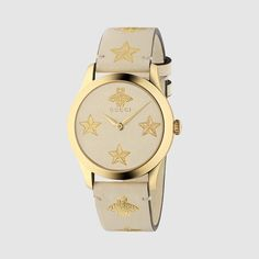 0cde697e04f The Gucci bee—a historical symbol from the archives—is combined with the  star motif. The print appears in gold against the white leather dial and  strap of ...