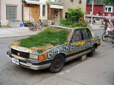 Hand painted car planter in Kensington Market, Toronto.  see more car planters http://thegardeningcook.com/car-planters/