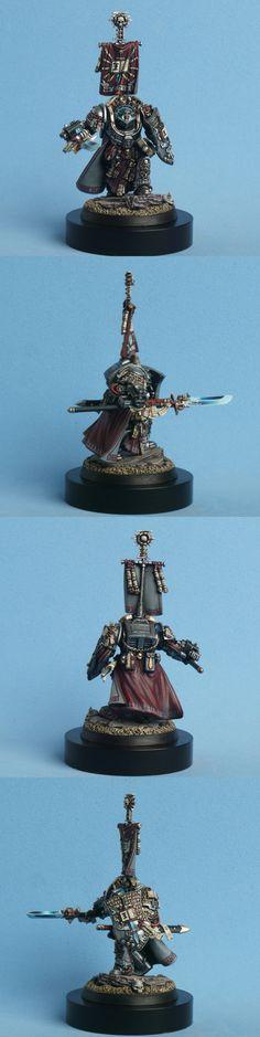 Grey Knight Grand-Master Titus. Wargear: nemesis-halbeard; forearm stormbolter (w/ psybolt- ammo); storm-shield.