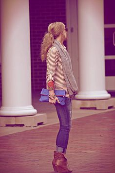 Striped shirt, gray scarf, jeans, and booties.