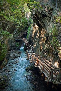 Footbridge, a creek in the Alps, Fieberbrunn, Tyrol, Austria. Sigmund Thun - Klamm by Michal Soukup