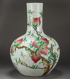 A magnificent famille-rose peach vase. Stick neck, the body painted with a peach tree. A blooming rose tree was glazed next to the peach tree with white glaze. The clay carcass is thick. The white glazed bottom marked with Da Qing Qiang Long Nian Zhi.
