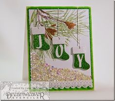 Glitter stockings hung from pinecone boughs, above glittery snow featuring Dreamweaver Stencils dies, cardstock by Core'dinations and images from Stampendous. #handmadecards #cardmaking #Christmas #dies