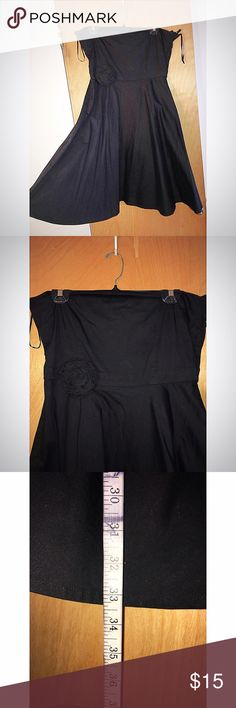 Black H&M empire waist dress. Cute! H&M black empire waist dress with a tube top bodice. It has a cute floral decor on the breast area. It's a cute little black dress. An LBD with a cute simple touch. It's stretch cotton, zippered back. Size 12. Worn once to a wedding.  Flaws: top of zipper needs minor repairing but it's a great dress! H&M Dresses Strapless