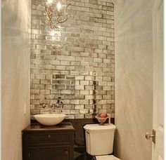 Use mirrored tiles in a bathroom without windows