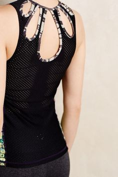 Love the cut out back detail of this tank! | Anthropologie