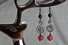 Black Copper Wire Spiral Earrings with Red Quartz and Black Agate, $10 at Etsy from JeanneAshleyJewelrey. Love this,