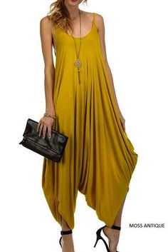 Luxuriously soft sleeveless jumpsuit with relaxed flattering draping. - 100% rayon. - Colors Available: Turquoise, Mustard and Black