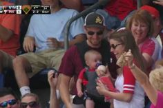 Someone will have quite a souvenir when he grows up! This Phillies fan managed to catch a fly ball while carrying his infant child, without skipping a beat. Lets Celebrate, Fathers, Growing Up, Infant, Dads, Play, Children, Photography, Souvenir