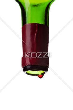 drop falling from a empty wine bottle. - Drop falling from a empty wine bottle isolated on white.