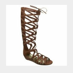 """NWT Carlos Santana brown gladiator sandals Today's Special! Brand new with tag and original box. Super chic Carlos Santana gladiator sandals in brown faux leather. Beautiful front lace up with back zipper. Very comfortable, I have the black ones but these brown ones are new. Size 8, true to size. Slight wedge, 1 1/2"""" high. Sold out online and in stores in this color and size! No PayPal or trades. Carlos Santana Shoes Sandals"""