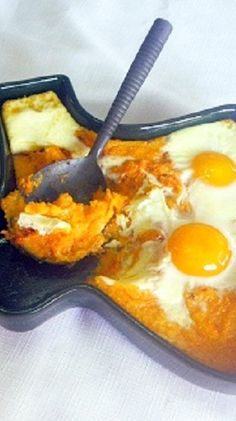 Heavenly Eggs in Hell - Baked Eggs with Chipotle Sweet Potato Grits... I love this breakfast... Grits flavored with SWEET POTATOES, made spicy with some pepper ADOBE Sauce and eggs... the whole combo gets backed and delicious! The recipe is all in the pin! And you will LOVE this!