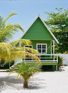 A brightly painted beach cottage in the fishing village of Placencia