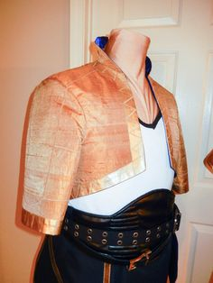 Gold jacket made of butterscotch gold dupioni fabric. It has purple satin lining. $200 https://www.etsy.com/listing/191170518/fire-emblem-tactician-custom-commission