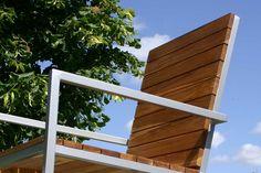 Teak slats over an aluminium frame.
