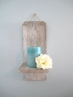 Cute hanging wooden candleholder.