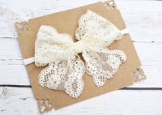 Handmade+4+inch+wide+delicate+ivory+lace+bow+on+either+one+size+fits+all+nylon+elastic+band+or+1/8th+inch+skinny+elastic+in+your+choice+of+size.+