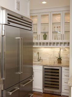 Stainless steal appliances, wine cooler all white cabinets back lit open cabinets gorgeous!