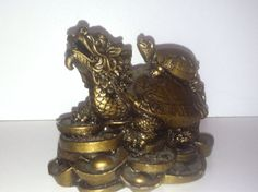 For some reason this dragon & turtle prosperity sculpture has what appears to be the description for a set of Foo dogs... but whatever. I still heart turtles, and prosperity isn't so bad either. :)  *** Feng Shui Dragon Turtle by denela on Etsy, $7.99