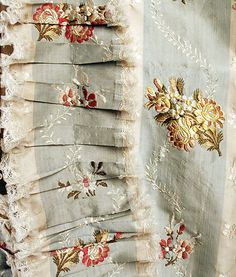Detail trimming, robe à la francaise, North America, 1765-1780. Cream and pale blue striped silk brocaded with floral sprays in multicoloured silk threads.