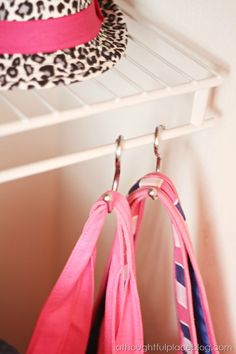 Use shower hooks to hang purses, bags, etc. in closets
