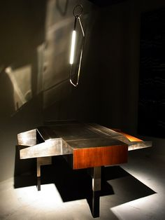 Recycled wooden panels, black painted woods, Aged silvered brass sheet . Writing Desk by Vincenzo De Cotiis