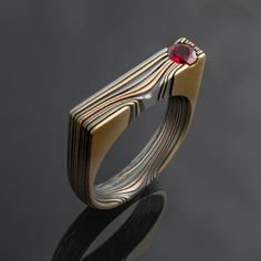 bae2edc98 Contemporary Flat Top Mokume Gane Seamless Edge Grain Ring with Ruby in  Oxidized Firestorm