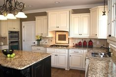White Kitchen with gray walls and black island.                      Love the 2-tone and countertops