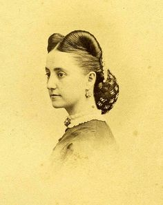 I need to do some research on the hairstyle, but believe it's 1850 or 60. It's similar to a hairstyle in the 1940's, except the forehead had the hair roll attachedto the sides (covering the middle part).