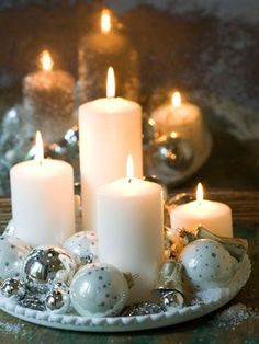 Light a Candle Add some shimmer and shine to your holiday decor with candles and sparkly silver-and-white ornaments. Arrange chunky pillar candles (in varying heights) on a round tray and surround with Christmas ornaments, rhinestone jewelry, and baubles (search flea markets and thrift stores for inexpensive pieces).