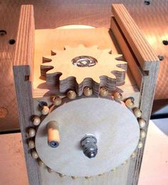 Novel method for creating wooden gears uses beads for the gear teeth Wooden Gear Clock, Wooden Gears, Gear Template, Wood Projects, Woodworking Projects, Plunge Router, Marble Machine, Mechanical Art, Pallets