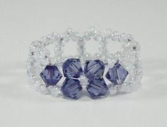 "Swarovski Crystal beaded ring size 7    *****FREE SHIPPING******    Beautiful eye catching sparkle yet delicate and elegant. This hand crafted item is a size 7 and measures approximately 1/4"" wide (or 6mm)    Available for custom order in any size and color combination. $7.00"