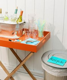A beverage station separate from the food lets guests mix drinks and mingle. Stock the bar with cups, straws (to double as stirrers) and plenty of ice — a large metal pail will keep bottles and cans frosty, but consider an insulated cooler for an extra cubes. Click through for more summer party ideas and outdoor entertaining tricks.