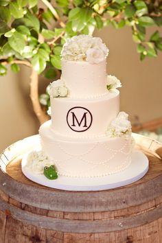 Monogrammed wedding cake {Photo: Heather Scharf Photography; Cake: Fleur de Lisa Cakes}