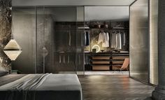 Velaria sliding doors with brushed lead structure and bronze net glass. Zenit walk-in closet with brown aluminium uprights, castoro regenerated leather and coal larch melamine accessories.