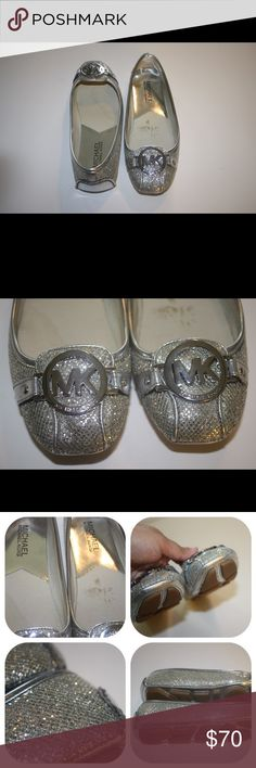 """Micheal Kors Silver Glitters Flats Worn three times. Size is 5M. Brand is Michael Kors. Got them from Macy's. Comes with the box. Look at the third and fourth pictures for details and conditions of the shoes. There are a few scratches on the back and the front. Really comfortable. Sorry no trades. If you have any questions please ask. If you don't like the price please use the offer button. Have an amazing day! """"Great Sense of Style"""" MICHAEL Michael Kors Shoes Flats & Loafers"""