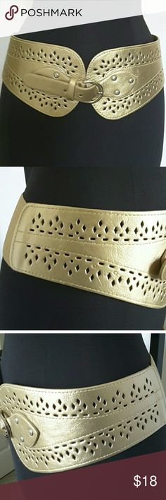 Stunning Metallic Gold Waist Belt Size S/M This is a beautiful faux leather metallic gold waist belt that is in great condition.  My home is smoke-free and pet-free.  Check out the other items in my closet to bundle two or more items for a great bundle discount.  I consider all offers.  Happy POSHING! Accessories Belts