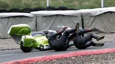 Synchronised dismounting. Sidecar rider Mike Bellaby and passenger Karl Underwood took a tumble when racing at Knockhill near Dunfermline. William Wheelans said that both men were unhurt and rode the bike to the pits.