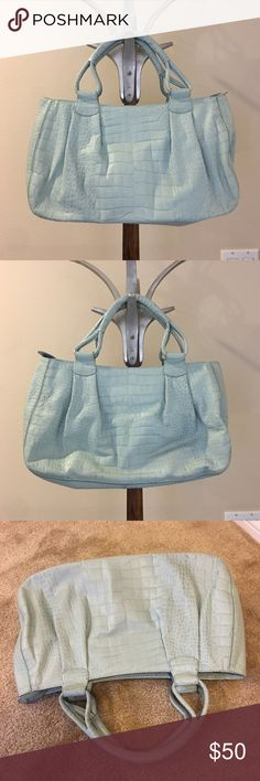 COLE HAAN sky blue textured leather purse COLE HAAN sky blue textured leather purse in gently worn preowned condition. Roomy interior with several pockets. Pretty lavender colored lining.  Double handle purse. Please ask questions prior to purchase. 🚫trades, reasonable offers only. Cole Haan Bags Totes