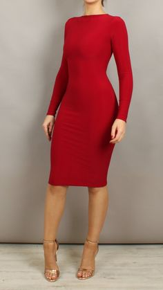 A knee length bodycon dress featuring an elegant high neck and high back design. Model wears a size S. Product Details Production Hand made in England using h
