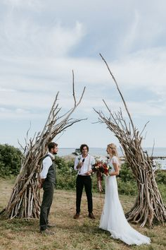 Driftwood ceremony arch at this naturally bohemian wedding at the Lookout | Image by  Emily Delamater Photography