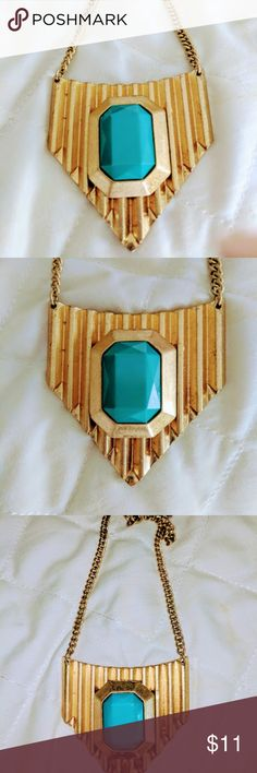 DYNAMIC Golden/Turquoise Chevron Necklace GORGEOUS Chevron shaped and waffle curves necklace with a teal/turquoise emerald-shape piece embedded in the center.  It hangs from a substantial yet elegant chain. Lobster claw closure. Will arrive in a white box with gray ribbon. It is a FABULOUS and impactful piece.  Length = 28 in. length of chevron center piece - 2 in. Width of chevron center piece -  2 1/2 in. Jewelry Necklaces