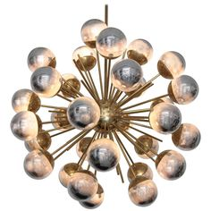 Exceptional Huge Sputnik Murano Glass and Brass Chandelier | From a unique collection of antique and modern chandeliers and pendants at https://www.1stdibs.com/furniture/lighting/chandeliers-pendant-lights/