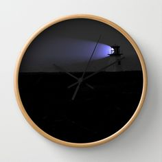 Lighthouse+with+purple+light+Wall+Clock+by+Claude+Gariepy+-+$30.00