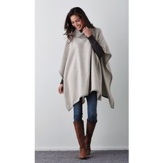 Effortlessly elegant, this turtleneck poncho is a layer of luxurious light-weight warmth for the changing seasons. Soft alpaca.